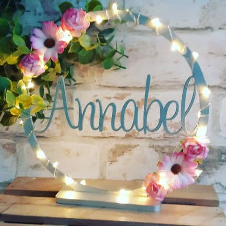 20cm free standing name hoop with flowers. Circular name sign with stand