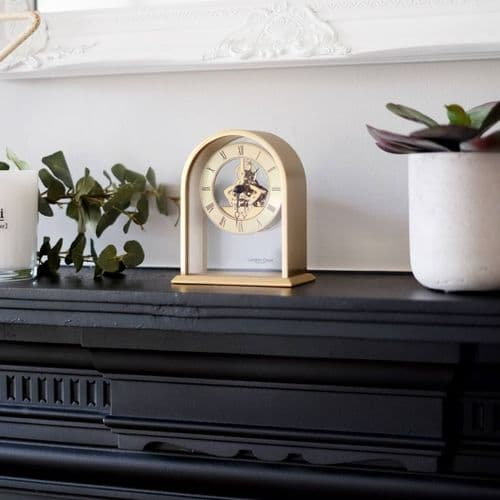 03128 Skeleton Clock Gold Coloured Curved Arch Top Metal And Glass Mantle London Clock Company
