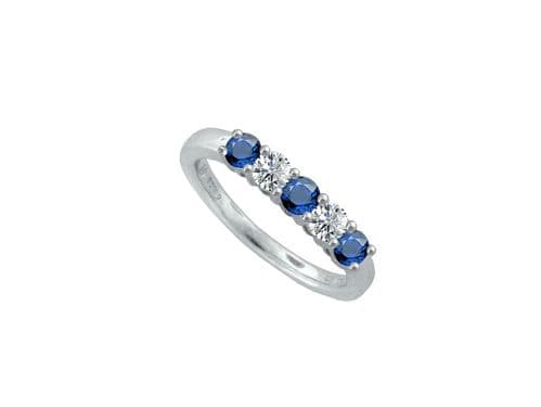 Blue Sapphire And Diamond Claw Set Eternity Ring White Gold
