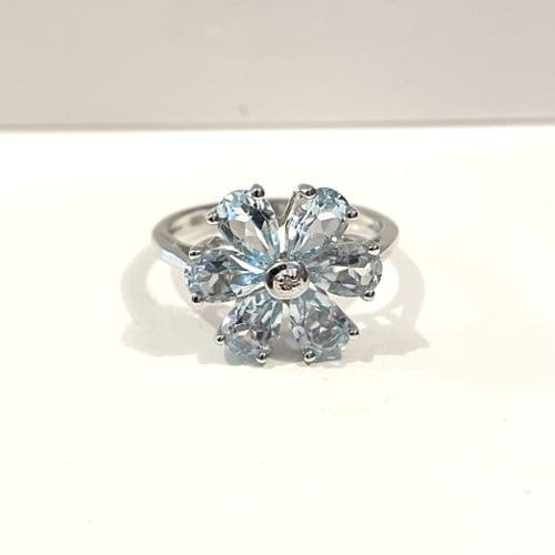Blue Topaz And Diamond Round Sterling Silver Daisy Petal Cluster Ring