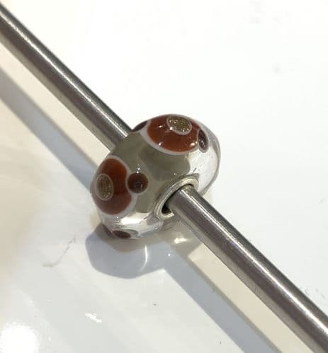 Grey with a brown circle and gold centre black dotted Unique Trollbeads