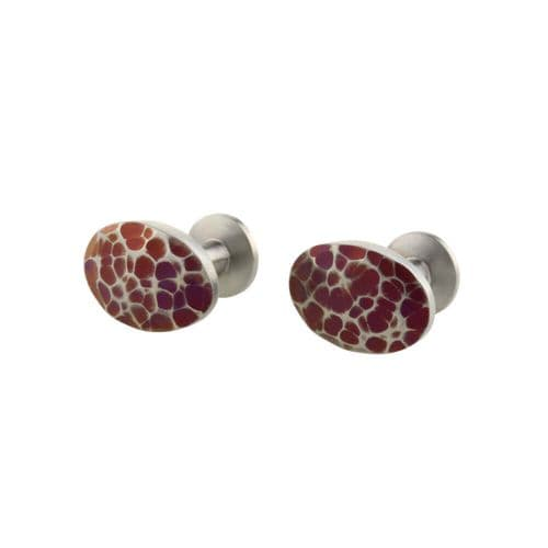 Oval solid titanium brown dotted cufflinks