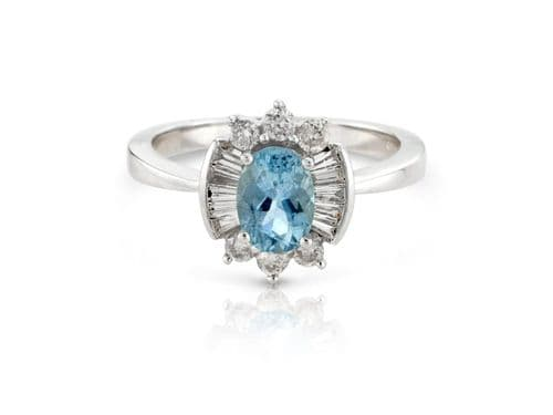 White gold aquamarine and diamond cluster ring with baguette diamonds