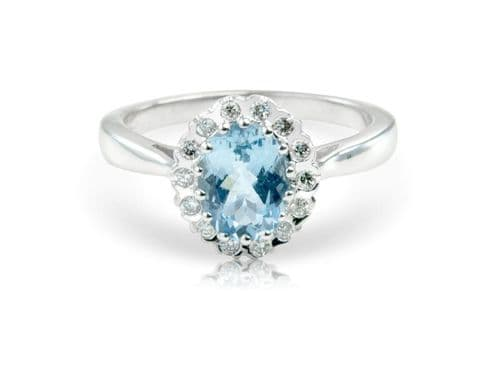 White gold aquamarine and diamond oval cluster ring