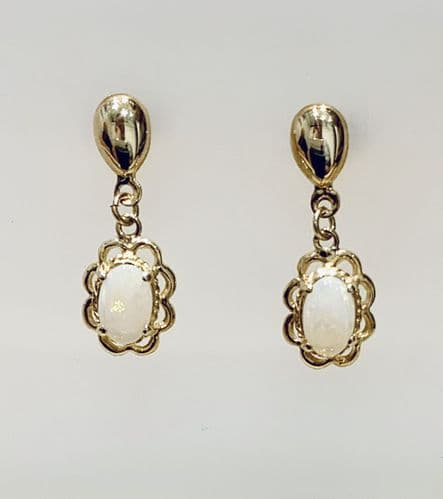 Yellow Gold Opal Oval Drop Earring With A Fancy Edging