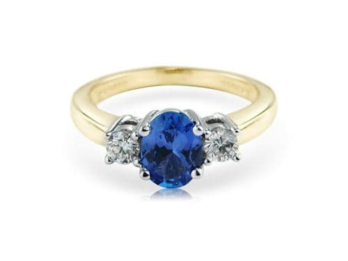 Yellow gold oval cut tanzanite and diamond trilogy ring