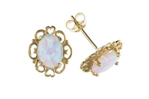Yellow Gold Oval Opal Stud Earrings With A Pierced Setting