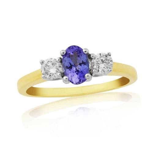 Yellow gold tanzanite and diamond three stone trilogy ring